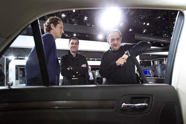 Sergio Marchionne, CEO of Fiat and Chrysler, right, has moved Saad Chehab, center, of Detroit from Chrysler to global marketing chief of Maserati. / Bloomberg
