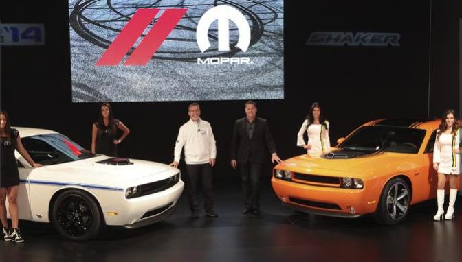 """Tim Kuniskis (right), President and CEO - Dodge Brand, and Pietro Gorlier (left), President and CEO - Mopar Brand, made a number of prominent announcements at the 2013 Specialty Equipment Market Association (SEMA) show at the Las Vegas Convention Center this year, spotlighting a 2014 Dodge Challenger R/T Shaker, a limited-edition Mopar '14 Challenger, three """"Scat Package"""" performance stage kits and the unveiling of 20 Mopar-customized concept vehicles."""