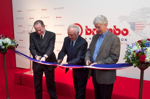 Alberto Bombassei, chairman of Brembo S.p.A., Daniel Sandberg, president and CEO of Brembo North America, and Michigan Governor Rick Snyder cut the ceremonial ribbon to mark the grand opening of Brembo's expanded manufacturing operations in Homer, Michigan. (PRNewsFoto/Brembo)