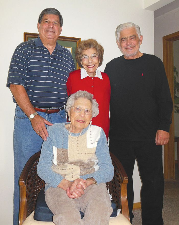 Henry Matranga, Rose Sherrard and Joe Matranga stand with their mother, Josephine McKenney, of St. Clair Shores, who will turn 104 on Oct. 23. (Photo by Kristyne E. Demske)
